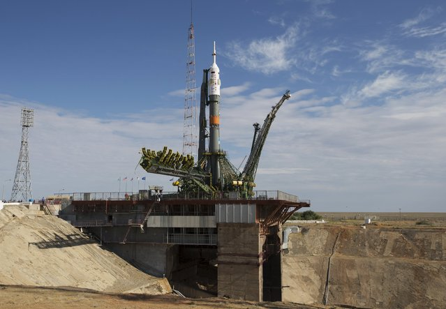 The Soyuz TMA-17M spacecraft is lifted to its launch pad at the Baikonur cosmodrome, Kazakhstan, July 20, 2015. (Photo by Shamil Zhumatov/Reuters)