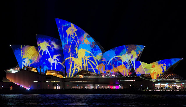 A paint-splatter design is projected onto the sails of the Sydney Opera House during the opening night of the annual Vivid Sydney light festival in Sydney, Australia May 27, 2016. (Photo by Jason Reed/Reuters)
