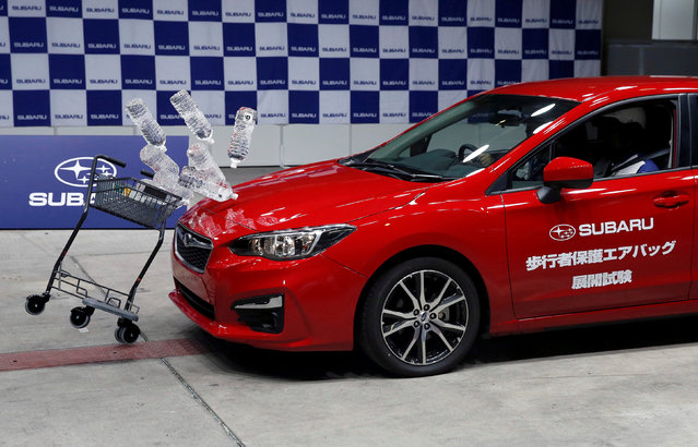 Subaru's new XV hits a shopping cart carrying water bottles during a collision test demonstration at its factory in Ota, north of Tokyo, Japan May 24, 2017. (Photo by Kim Kyung-Hoon/Reuters)