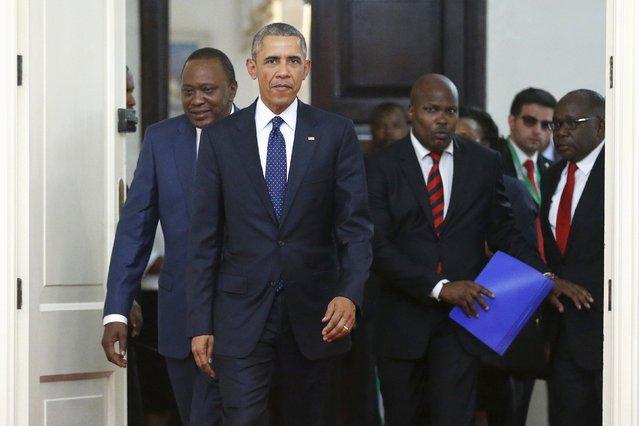 Kenya's President Uhuru Kenyatta (L) and U.S. President Barack Obama (2nd L) arrive for a bilateral meeting at the State House in Nairobi July 25, 2015. (Photo by Jonathan Ernst/Reuters)