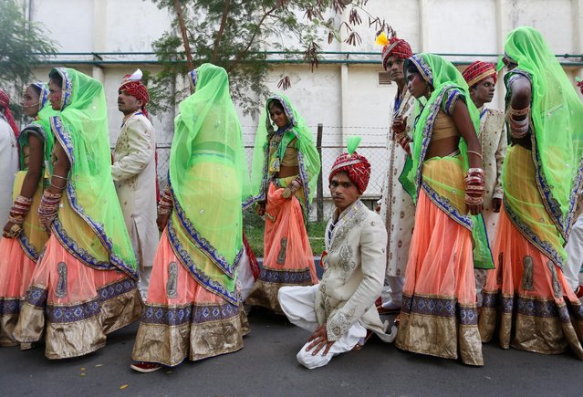 Brides and grooms arrive for a mass wedding ceremony organised for underprivileged and physically challenged couples in Mumbai, India, May 29, 2016. (Photo by Danish Siddiqui/Reuters)