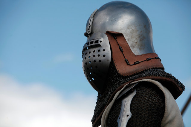 A man wears armor during the reenactment of a tournament of knights fight, in Agincourt, northern France, Saturday, July 25, 2015. (Photo by Thibault Camus/AP Photo)