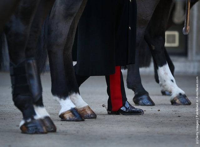 he booted leg of a cavalry officer of The Household Cavalry Mounted Regiment (HCMR) is seen amongst horses legs during parade at Hyde Park Barracks