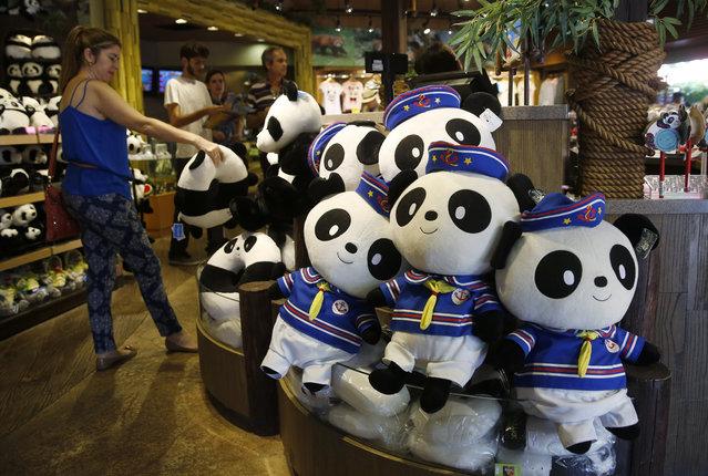 Visitors look at panda souvenirs at the shop at Ocean Park in Hong Kong, Tuesday, July 28, 2015. (Photo by Kin Cheung/AP Photo)