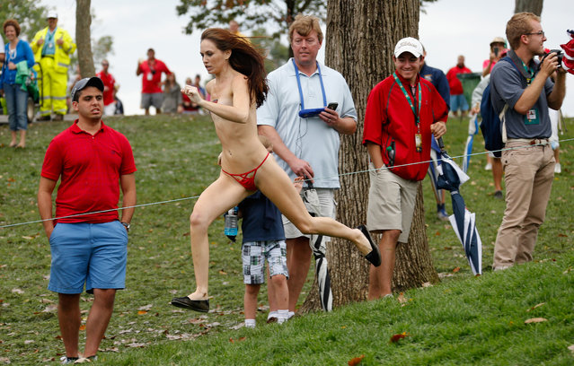 A streaker runs on the 18th hole during the Day Four Singles Matches at the Muirfield Village Golf Club on October 6, 2013  in Dublin, Ohio. (Photo by Gregory Shamus/Getty Images)