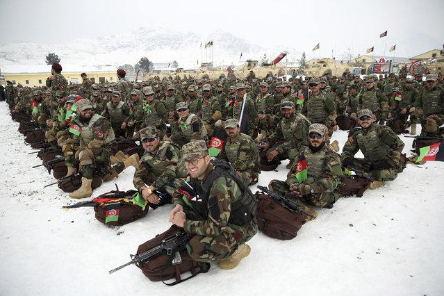 Afghan Army commandos attend their graduation ceremony after a 3 1/2 month training program at the Commando Training Center, on the outskirts of Kabul, Afghanistan, Monday, January 13, 2020. (Photo by Rahmat Gul/AP Photo)
