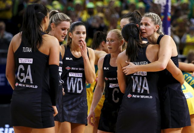 Members of the New Zealand team react after losing the Netball World Cup final game against Australia in Sydney, Australia, August 16, 2015. (Photo by David Gray/Reuters)