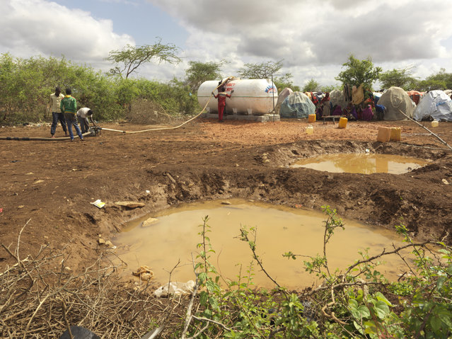 Dirty and contaminated pools of water bring disease and harbour infections. (Photo by Peter Caton/Mercy Corps)