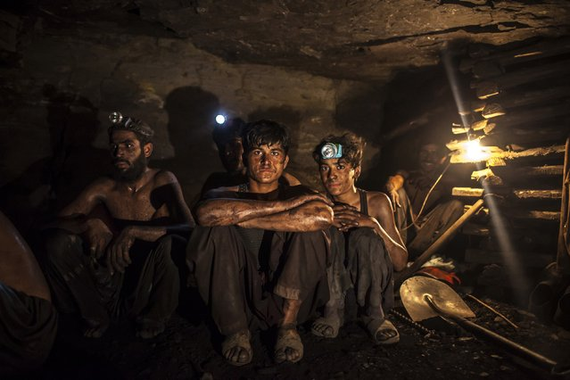 Miners pose for a photograph at the coal face inside a mine in Choa Saidan Shah, Punjab province, April 29, 2014. (Photo by Sara Farid/Reuters)