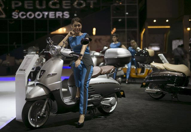 A model sits on a Peugeot scooter on display at the Indonesia International Motor Show in Jakarta, Indonesia August 21, 2015. (Photo by Darren Whiteside/Reuters)