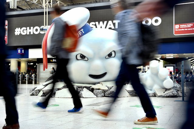 Stay Puft Marshmallow Man is seen on the concourse at Waterloo Station, July 11, 2016, in London. Ghostbusters take over Waterloo Station as Stay Puft Marshmallow Man smashes through the concourse during the morning rush-hour. (Photo by Gareth Cattermole/Getty Images)