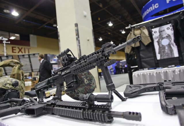 """An AR-15 style rifle is displayed at the 7th annual Border Security Expo in Phoenix, Arizona, in this file photo taken March 12, 2013. Wal-Mart Stores Inc, the United States' top seller of guns and ammunition, said on Wednesday it would stop selling the AR-15 and other semi-automatic rifles stores because of sluggish demand and focus instead on """"hunting and sportsman firearms"""". (Photo by Joshua Lott/Reuters)"""