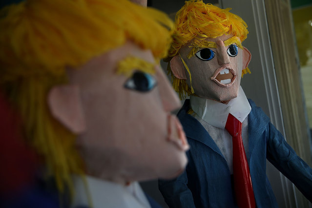 Donald Trump pinatas are displayed in the window at Pinata Art on August 28, 2015 in San Francisco, California. Donald Trump pinatas are selling out at stores in San Francisco's Mission District where many Latinos live. (Photo by Justin Sullivan/Getty Images)