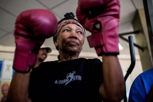 "77 year-old Gladys Ngwenya (C) prepares to take part in a ""Boxing Gogos"" (Grannies) training session hosted by the A Team Gym in Cosmo City in Johannesburg on September 19, 2017. (Photo by Gulshan Khan/AFP Photo)"