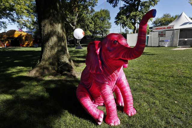 A pink elephant sculpture sits adjacent to a medical tent at the Electric Zoo music festival venue on New York's Randall's Island, Friday, August 29, 2014. The final day of last year's festival was called off after two people died from an overdose of MDMA combined with hyperthermia. (Photo by Jason DeCrow/AP Photo)