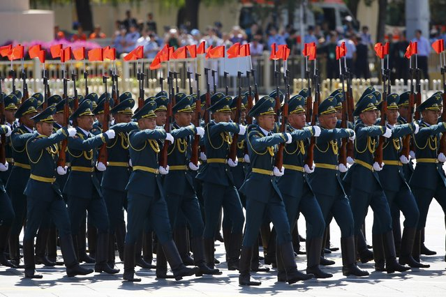 Kyrgyzstan's soldiers march during the military parade marking the 70th anniversary of the end of World War Two, in Beijing, China, September 3, 2015. (Photo by Damir Sagolj/Reuters)