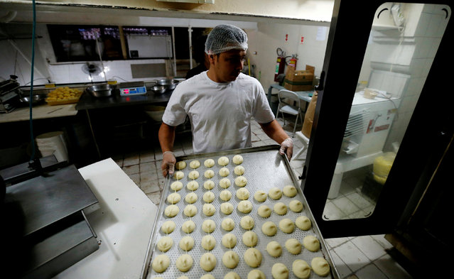 A worker prepares pao de queijo (cheese bread) at the Cultivar cafe and store in Santa Teresa neighbourhood in Rio de Janeiro, Brazil, July 28, 2016. (Photo by Sergio Moraes/Reuters)
