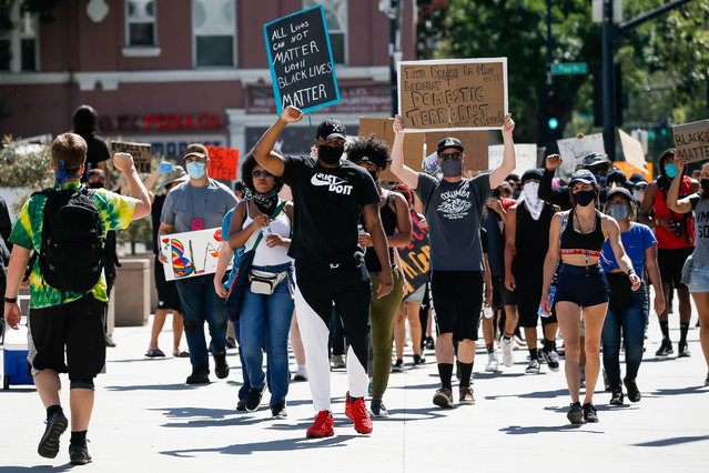 People walk past city hall during a demonstration over the police killing of George Floyd in downtown San Jose, Calif., on Wednesday, June 3, 2020. (Photo by Randy Vazquez/Bay Area News Group)