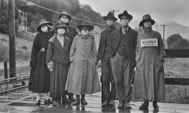 A group of mask-wearing citizens, somewhere in California, during the flu pandemic of 1918. (Photo by Niday Picture Library)