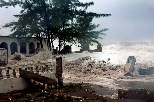 Waves brought by Hurricane Sandy crash on a house in the Caribbean Terrace neighborhood in eastern Kingston, Jamaica. Hurricane Sandy pounded Jamaica with heavy rain as it headed for landfall near the country's most populous city on Wednesday. (Photo by Collin Reid/Associated Press)