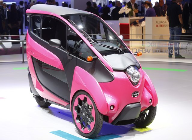 A three wheel design and ultra compact Toyota I-Road electric car is displayed on media day at the Paris Mondial de l'Automobile, October 2, 2014. The Paris auto show opens its doors to the public from October 4 to October 19. (Photo by Jacky Naegelen/Reuters)