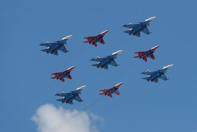 Russian army MiG-29 jet fighters of the Strizhi (Swifts) and Su-30SM jet fighters of the Russkiye Vityazi (Russian Knights) aerobatic teams fly in formation during the Victory Day Parade in Red Square in Moscow, Russia June 24, 2020. (Photo by Maxim Shemetov/Reuters)