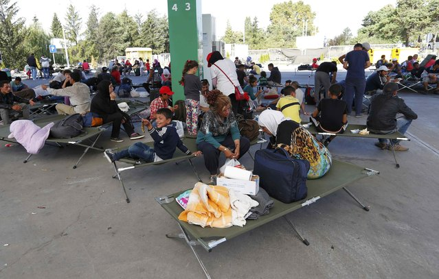 Migrants rest at a gas station in Beli Manastir, Croatia September 18, 2015. (Photo by Laszlo Balogh/Reuters)