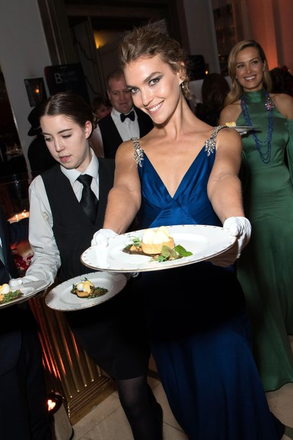 Arizona Muse and Petra Nemcova serve dinner at the BOVET 1822 Brilliant is Beautiful Gala benefitting Artists for Peace and Justice's Global Education Fund for Women and Girls at Claridge's Hotel on December 1, 2017 in London, England. (Photo by Vianney Le Caer/Rex Features/Shutterstock)