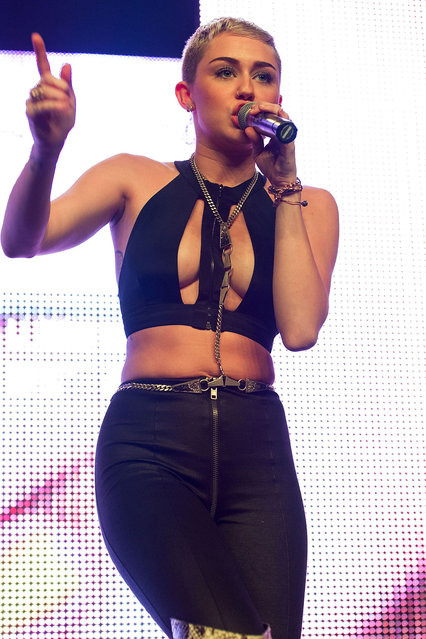 """Singer Miley Cyrus performs on stage during Borgore's """"Christmas Creampies"""" concert at the Fonda Theatre on December 8, 2012 in Hollywood, California. (Photo by Paul A. Hebert)"""