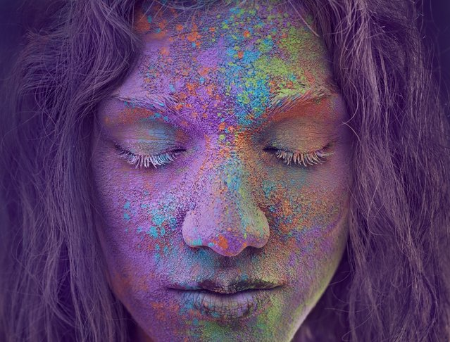 """Powder Color"". Personal project to explore the power of the color powder on face. Photo location: Montréal. (Photo and caption by Christopher Dormoy/National Geographic Photo Contest)"