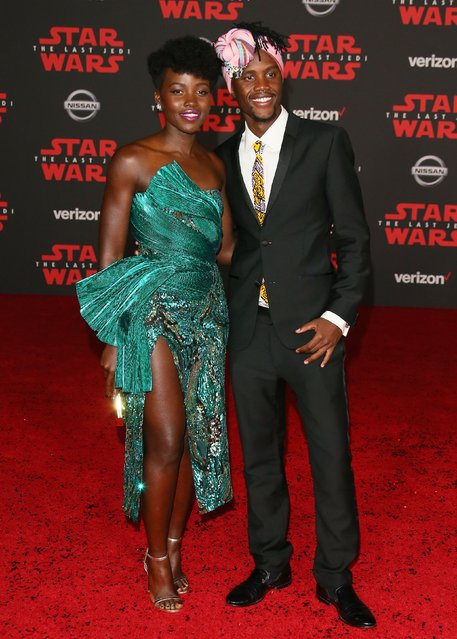 "Lupita Nyong'o and Peter Nyong'o arrive for the premiere of Disney Pictures and Lucasfilm's ""Star Wars: The Last Jedi"" at The Shrine Auditorium, in Los Angeles, California, on December 9, 2017. (Photo by Jean-Baptiste Lacroix/AFP Photo)"