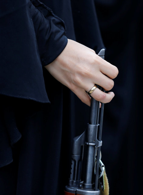 A woman loyal to the Houthi movement holds a rifle as she takes part in a parade to show support for the movement in Sanaa, Yemen September 6, 2016. (Photo by Khaled Abdullah/Reuters)
