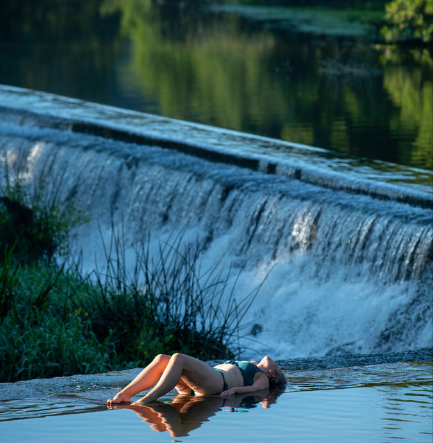 A woman cools off at Warleigh Weir on the River Avon near Bath, largest city in the county of Somerset, England on August 7, 2020. (Photo by Andrew Lloyd/The Sun)