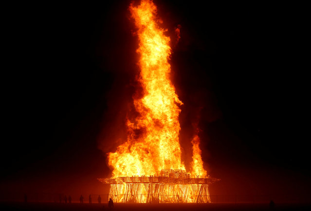 The Temple burns as approximately 70,000 people from all over the world gathered for the annual Burning Man arts and music festival in the Black Rock Desert of Nevada, U.S. September 3, 2017. (Photo by Jim Bourg/Reuters)