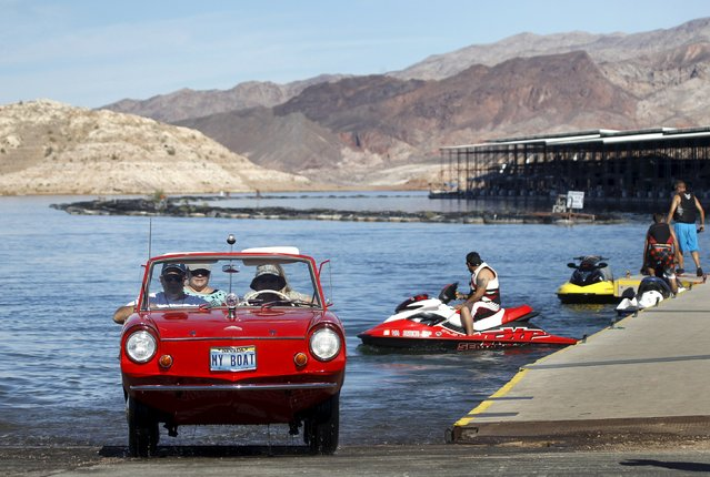James Spear of Henderson, Nevada drives his 1964 Amphicar out of Lake Mead after a trip to Hoover Dam during the first Las Vegas Amphicar Swim-in at Lake Mead near Las Vegas, Nevada October 9, 2015. (Photo by Steve Marcus/Reuters)