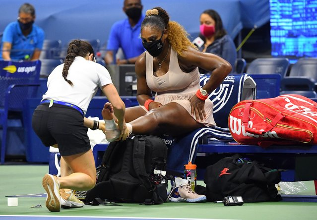 Serena Williams, of the United States, has her ankle taped by a trainer during a medical timeout during a semifinal match of the US Open tennis championships against Victoria Azarenka, of Belarus, Thursday, Sept. 10, 2020, in New York. (Photo by Robert Deutsch/USA TODAY Sports)