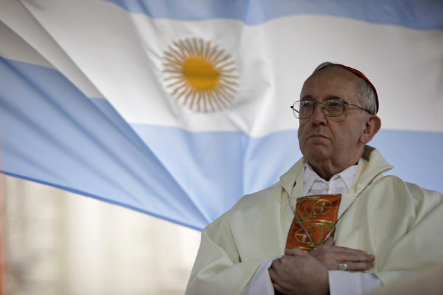 This August 7, 2009 file photo shows Argentina's Cardinal Jorge Bergoglio giving a mass outside the San Cayetano church in Buenos Aires. Bergoglio, who took the name of Pope Francis,  was elected on Wednesday, March 13, 2013 the 266th pontiff of the Roman Catholic Church. (Photo by Natacha Pisarenko/AP Photo)