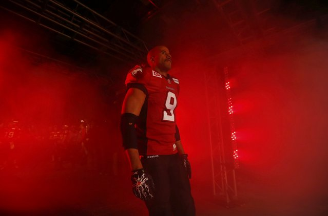 Calgary Stampeders' Jon Cornish walks to the field before facing the Hamilton Tiger Cats in the CFL's 102nd Grey Cup football championship in Vancouver, British Columbia, November 30, 2014. (Photo by Mark Blinch/Reuters)
