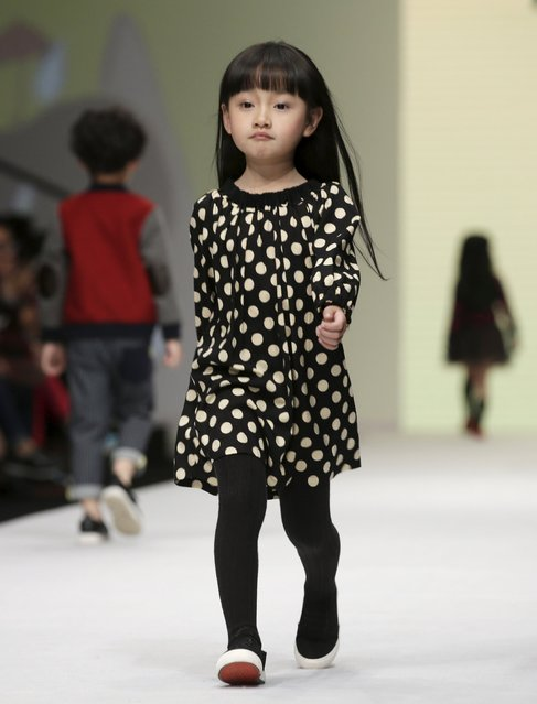 A model presents a creation for M.latin children's wear collection at China Fashion Week S/S 2016, in Beijing, China, October 28, 2015. (Photo by Jason Lee/Reuters)