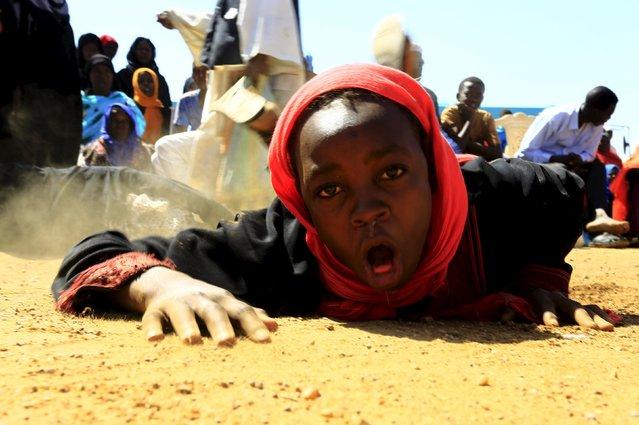 A believer reacts during a sermon by Shaq Boshraa, a spiritual healer, at a yard in Khartoum, Sudan, October 30, 2015. (Photo by Mohamed Nureldin Abdallah/Reuters)