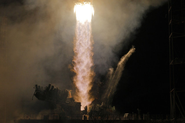 A Soyuz-FG rocket booster with the Soyuz TMA-08M space ship carrying a new crew to the ISS, blasts off from the Baikonur Cosmodrome, in Kazakhstan, on March 29, 2013. (Photo by Dmitry Lovetsky/AP Photo/The Atlantic)