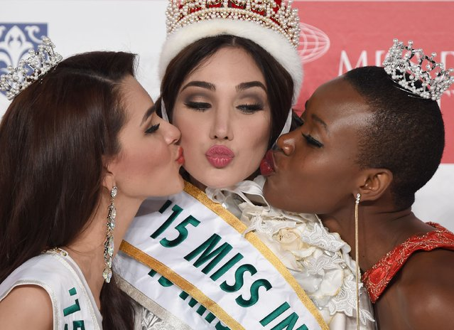 Miss Venezuela Edymar Martinez (C) is kissed by first runner-up Miss Honduras Jennifer Valle (L) and second runner-up Miss Kenya Eunice Onyango (R) after winning this year's Miss International beauty pageant during the Miss International beauty pageant in Tokyo on November 5, 2015. (Photo by Toru Yamanaka/AFP Photo)