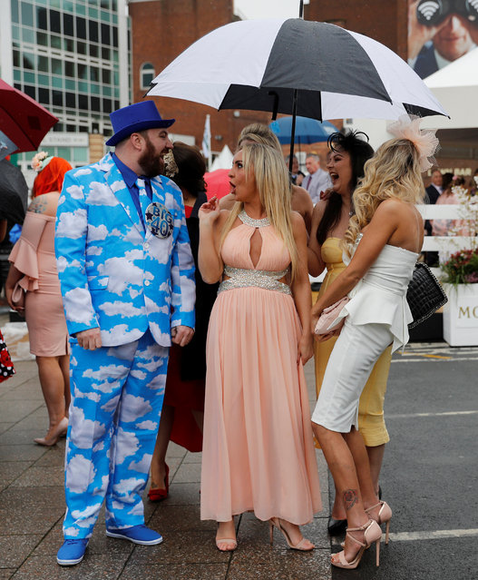 Racegoers arrive during Ladies Day at the Grand National Festival at Aintree Racecourse on April 13, 2018 in Liverpool, England. (Photo by Darren Staples/Reuters)
