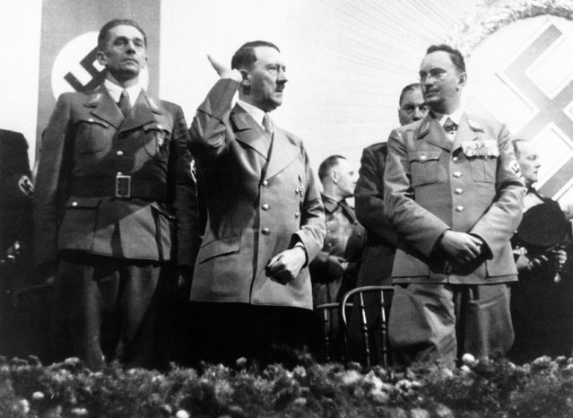 Adolf Hitler spoke at a propaganda meeting for the Reichstag election at Reichenberg on December 2. When the election takes place it will be the first time Sudeten Germans will have voted under the new regime. Hitler, centre, and Konrad Henlein, Sudeten chief, during the meeting at Reichenberg, Czech Republic on December 2, 1938. (Photo by AP Photo)