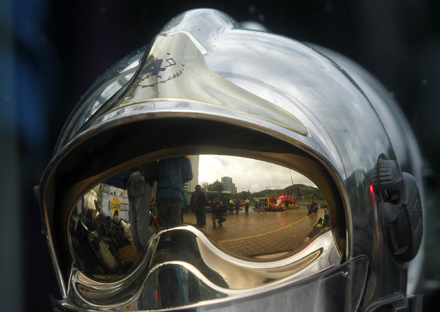 """Picture of a firefighter's helmet taken before firefighters climb the 1800 steps of the Costanera Centre Tower in Santiago as part of the """"Race for Life"""" aimed at encouraging organ donation in Chile, in Santiago, on October 16, 2016. (Photo by Claudio Reyes/AFP Photo)"""