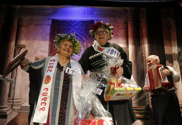 "Lida Maisuradze (L), 82, and Zurab Gogidze, 82, celebrate after wining the ""Super Grandmother and Super Grandfather"" contest in Tbilisi, January 5, 2015. (Photo by David Mdzinarishvili/Reuters)"