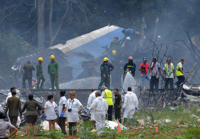 "Picture taken at the scene of the accident after a Cubana de Aviacion aircraft crashed after taking off from Havana's Jose Marti airport on May 18, 2018. A Cuban state airways passenger plane with 104 passengers on board crashed on shortly after taking off from Havana's airport, state media reported. The Boeing 737 operated by Cubana de Aviacion crashed ""near the international airport"", state agency Prensa Latina reported. Airport sources said the jetliner was heading from the capital to the eastern city of Holguin. (Photo by Adalberto Roque/AFP Photo)"