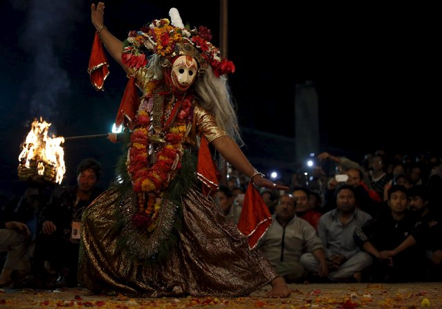 "A medium performs the religious dance ""Narsingh Avatar"" during the traditional Kartik dance festival at Patan Durbar Square in Lalitpur, Nepal November 24, 2015. (Photo by Navesh Chitrakar/Reuters)"