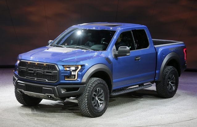 A Ford Raptor pickup truck is displayed during the first press preview day of the North American International Auto Show in Detroit, Michigan, January 12, 2015. (Photo by Mark Blinch/Reuters)