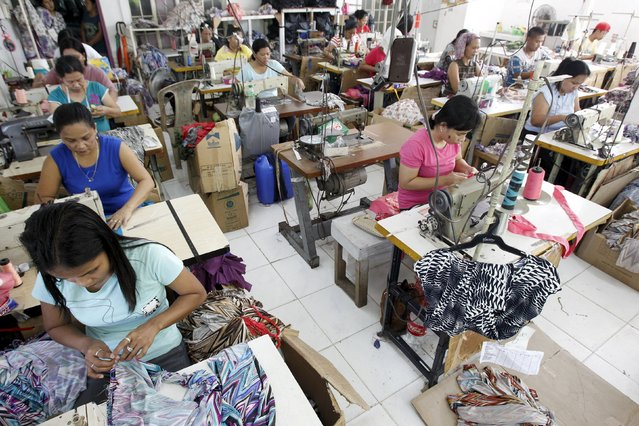 Garment workers sew maternity dresses at a factory of Additional Pelf Joys Trading Corp. at Taytay city, Rizal province, east of Manila in this May 1, 2013 file photo. The Philippines is expected to release inflation data this week. (Photo by Romeo Ranoco/Reuters)